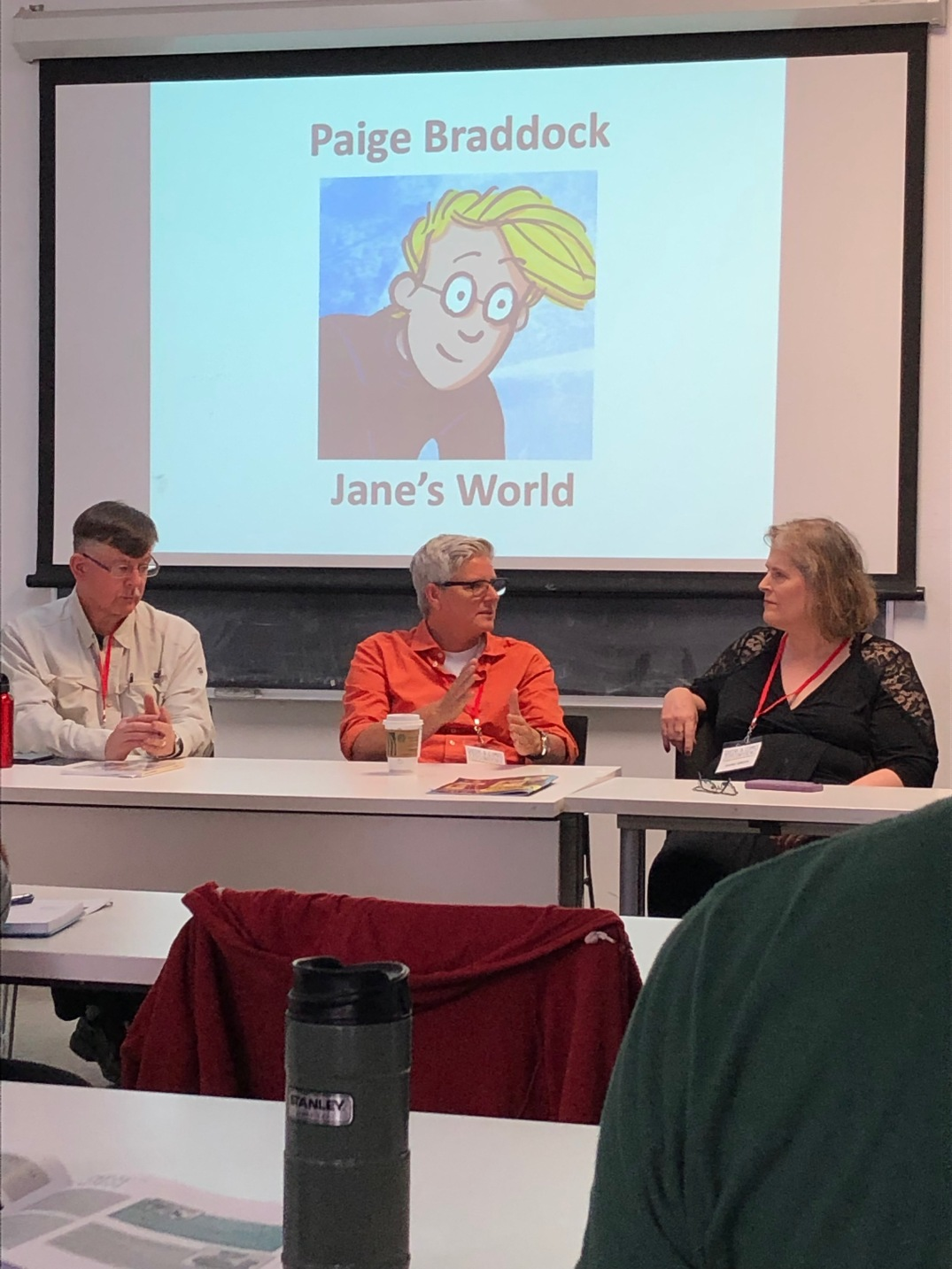 The Serialized Comics panel moderated by Jeff Krell. From left to right: Kurt Erichsen and Diana Green.